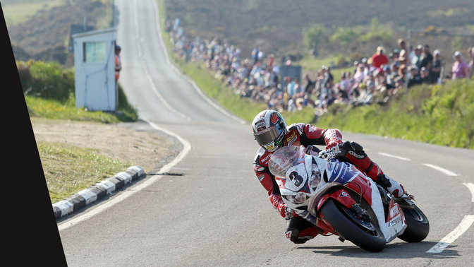 Front three quarter view of Honda CBR100RR and rider in the TT race.